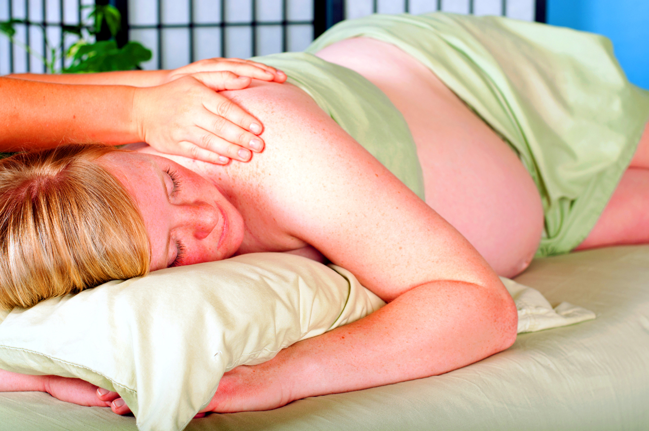 Woman Receiving Postnatal Massage
